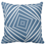 Blue pillow with square spiral pattern