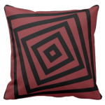 Red and black pillow with nested square spiral pattern