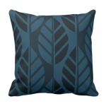 Blue throw pillow with leaves pattern