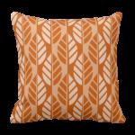 orange throw pillow with leaf pattern
