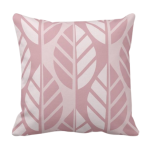 Pink throw pillow with leaves pattern