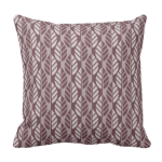 purple throw pillow with leaf pattern