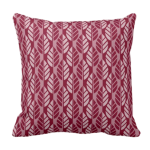 Throw pillow with red leaf pattern