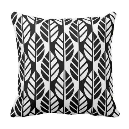 White throw pillow with black leaves pattern