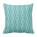 Turquoise throw pillow with leaves pattern