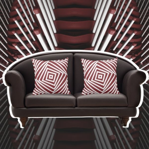Red and white throw pillows with spiral square pattern