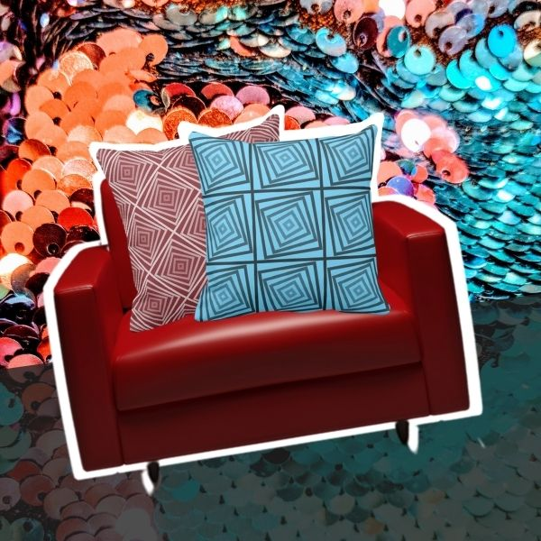 Red and turquoise throw pillows with spiral square pattern