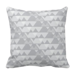 Grey triangle repeat pattern on square throw cushion