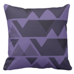 Purple triangle repeat pattern on square throw cushion