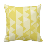 Yellow triangle repeat pattern on square throw cushion
