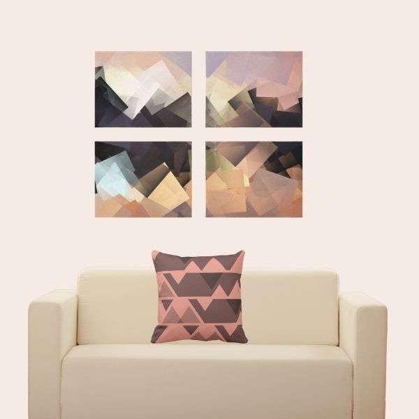 Sandy orange throw pillow with jaggered pattern on white armchair with abstract landscape art print