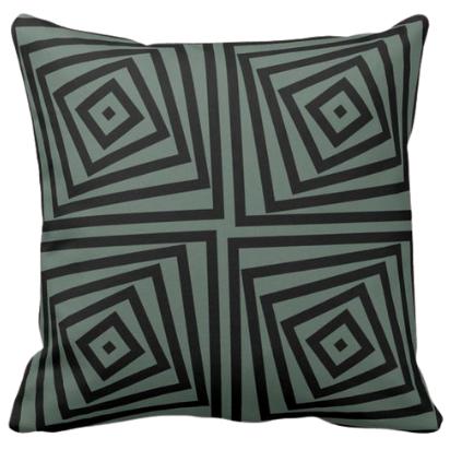 nested spiraling box on grey cushion
