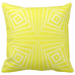 yellow pillow with spiraling square pattern