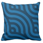 blue accent pillow with dark wave pattern