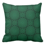 pillow in shades of green with a geometric circular pattern
