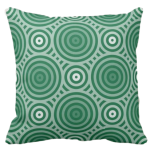 pillow in shades of green with a geometric circle pattern