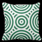 green pillow with a white geometric circle pattern