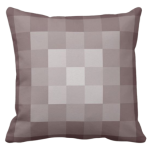 brown pillow with monochrome square pixel pattern