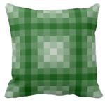 green pillow with monochrome square pixel pattern