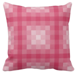 Pink pillow with monochrome square pixel pattern