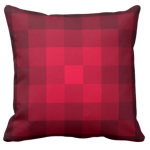 Red pillow with monochrome square pixel pattern