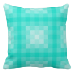 Turquoise pillow with monochrome square pixel pattern