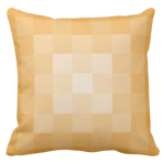 Yellow pillow with monochrome square pixel pattern