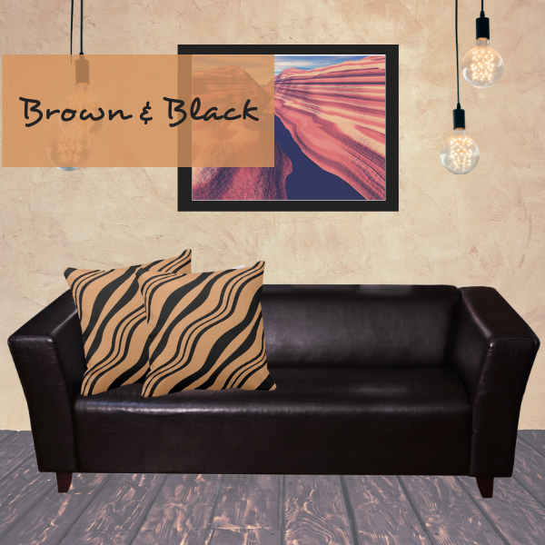 Brown and black throw pillows decorate a black couch in a modern living room
