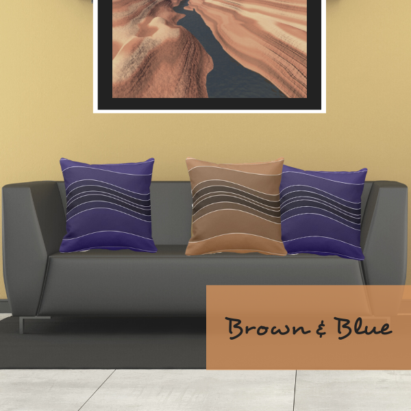 Brown and blue throw pillows with wavy stripes decorate a grey couch in a modern living room