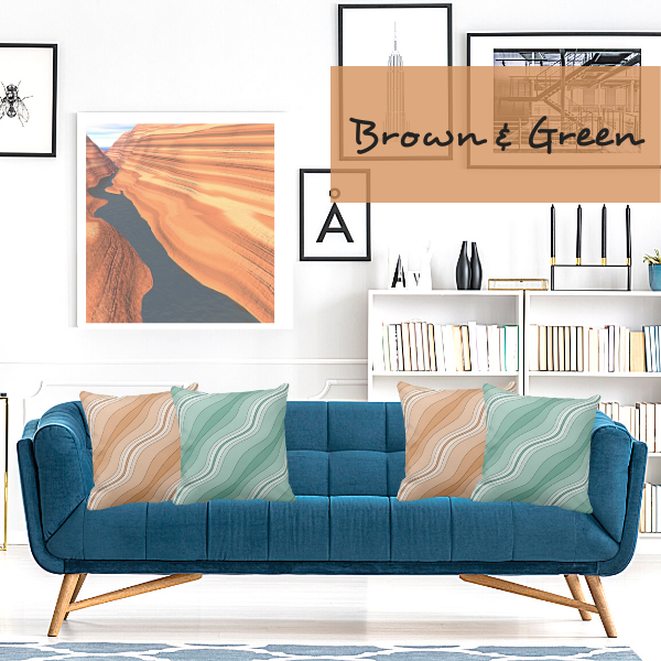 Elegant brown and green pillows with a wavy stripes pattern decorate a teal green couch