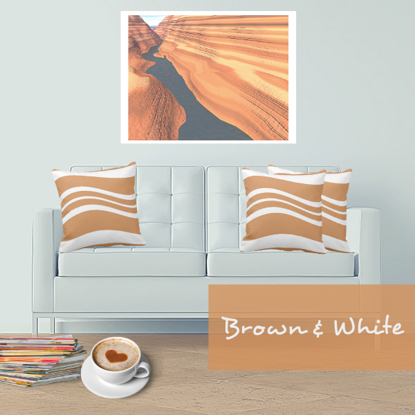 Brown and white throw pillows with wavy stripes decorate a white couch in a modern living room