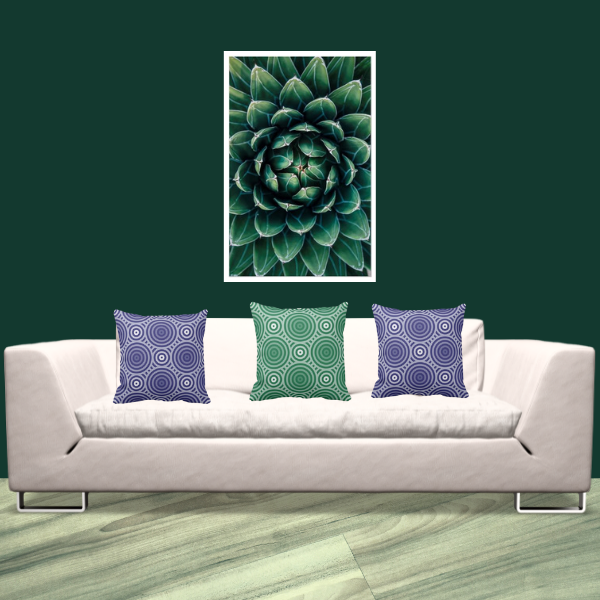 Succulent Wall Decor And Green And Blue Circle Patterned Pillow